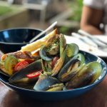 blue bowl of mussels