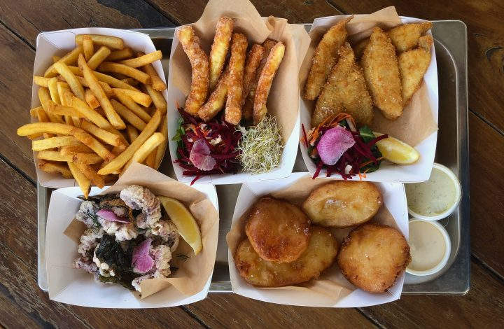 fish and chips on wooden table
